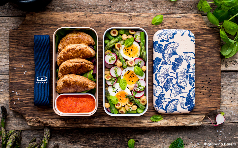 Empanadas with a mojo rojo sauce and Spring salad